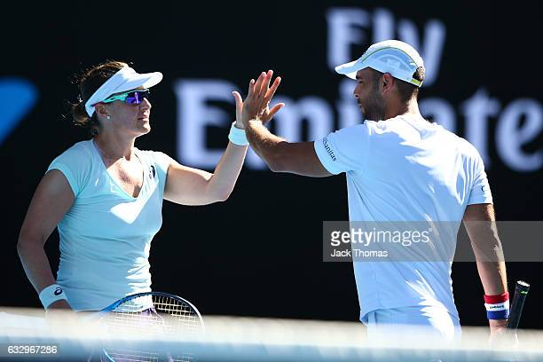 Abigail Spears and Juan Sebastian Cabal of Columbia celebrate a point in their Mixed Doubles Final against Sania Mirza of India and Ivan Dodig of...