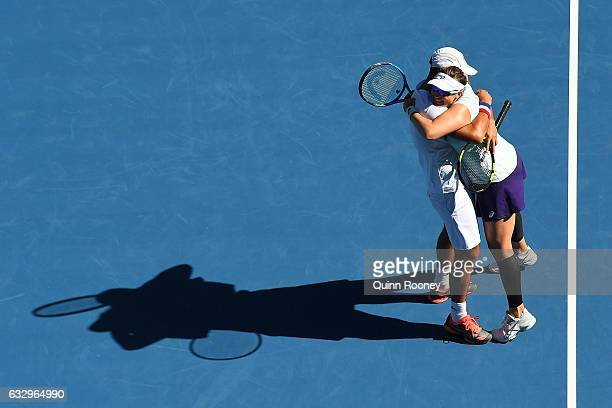 Abigail Spears and Juan Sebastian Cabal of Columbia celebrate championship point in their Mixed Doubles Final against Sania Mirza of India and Ivan...