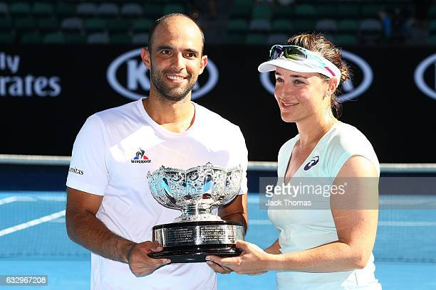 Abigail Spears and Juan Sebastian Cabal of Columbia pose with the championship trophy after winning their Mixed Doubles Final against Sania Mirza of...