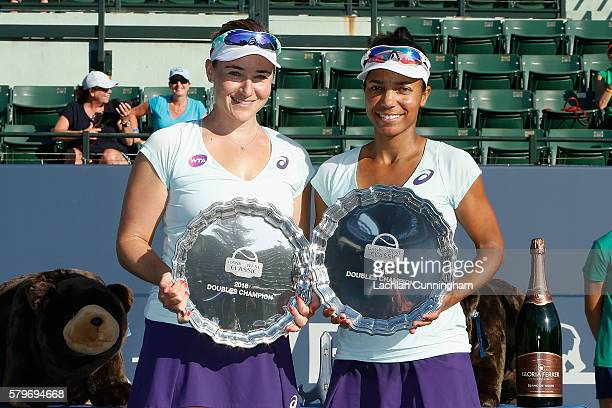 Abigail Spears and Raquel Atawo pose with their trophies after winning the final against Darija Jurak and Anastasia Rodionova during day seven of the...