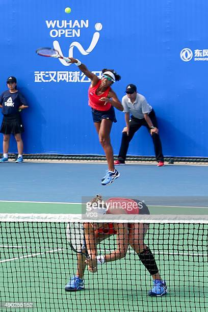 Abigail Spears and Raquel KopsJones of the United States in action during a match against Sara Errani and Francesca Schiavone of Italy on the Day one...