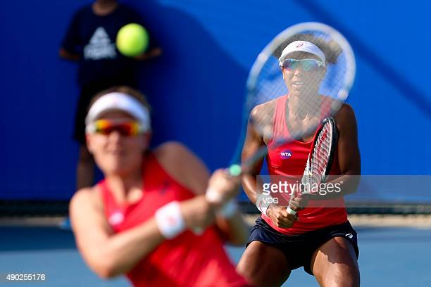 Abigail Spears and Raquel KopsJones of the United States in action during a match against Sara Errani and Francesca Schiavone of Italy in the first...