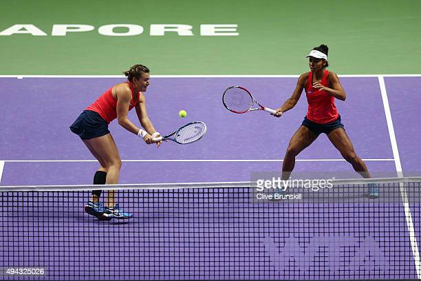 Abigail Spears and Raquel KopsJones of the USA in action against Sania Mirza of India and Martina Hingis of Switzerland during the BNP Paribas WTA...
