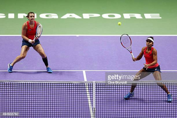 Abigail Spears and Raquel KopsJones of the USA in action against Andrea Hlavackova and Lucie Hradecka of Czech Republic during the BNP Paribas WTA...