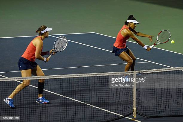 Abigail Spears and Raquel KopsJones of the USA in action during their women's doubles match against Misaki Doi and Kurumi Nara during day one of the...