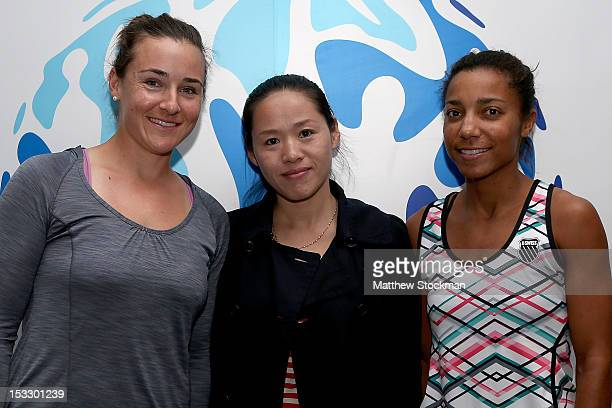 Abigail Spears of the United States and Raquel KopsJones of the United States sign autographs and pose for pictures at the USANA booth during the...