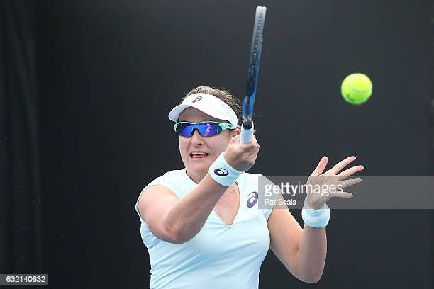 Abigail Spears of the United States plays a forehand in his first round match with Juan Sebastian Cabal of Colombia against Lucie Hradecka and Radek...