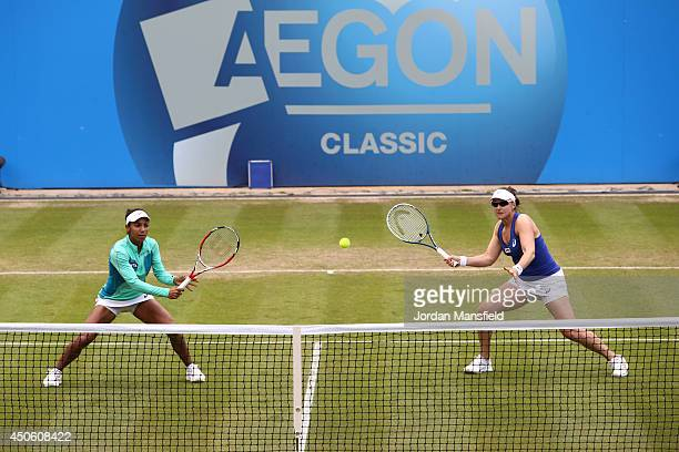 Abigail Spears of the USA and Raquel KopsJones of the USA in action during their doubles semifinal match against Cara Black of Zimbabwe and Sania...