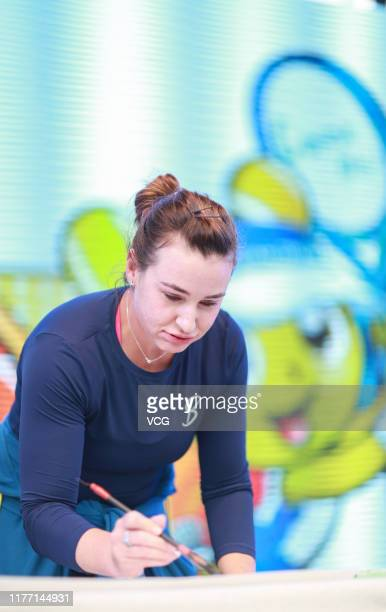 Abigail Spears of the USA learn to write calligraphy during an activity at Optics Valley International Tennis Center on day four of 2019 Dongfeng...