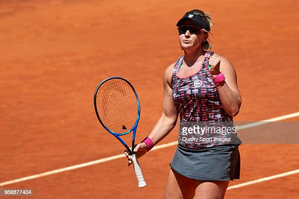 Abigail Spears of United States reacts during his match against Ekaterina Makarova of Russia and Elena Vesnina of Russia during day six of the Mutua...