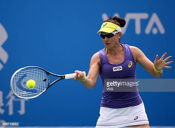 Abigail Spears of USA compete against Martina Hingis of Switzerland and Flavia Pennetta of Italy during day six of the 2014 Dongfeng Motor Wuhan Open...