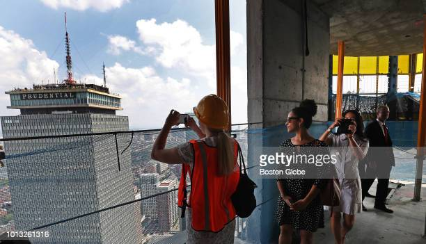 Abigail Summerville takes a photograph from the 59th floor during the topping off ceremony for One Dalton the tallest building in Boston in 40 years...