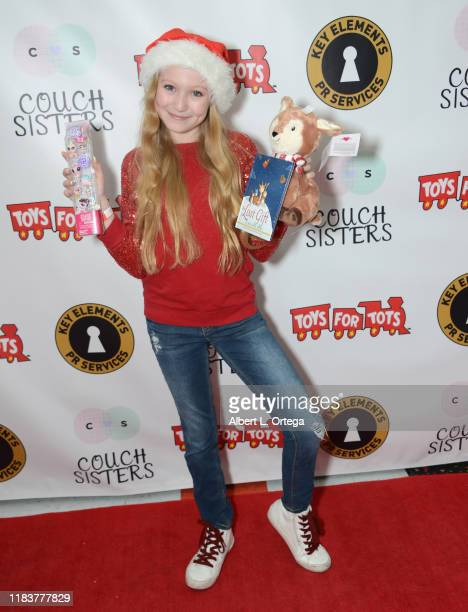 Abigail Zoe Lewis attends The Couch Sisters 1st Annual Toys For Tots Toy Drive held onNovember 20 2019 in Glendale California