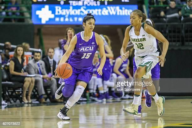Abilene Christian Wildcats guard Alexis Mason advances up the court during the NCAA women's basketball between Baylor and Abilene Christian on...