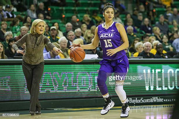 Abilene Christian Wildcats guard Alexis Mason dribbles up the court during the NCAA women's basketball between Baylor and Abilene Christian on...
