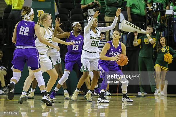 Abilene Christian Wildcats guard Alexis Mason looks to pass during the NCAA women's basketball between Baylor and Abilene Christian on December 1 at...