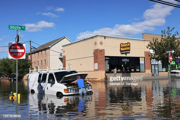 Abilio Viegas attempts to fix his flooded van on South Street on September 02, 2021 in Newark, New Jersey. Gov. Phil Murphy declared a state of...