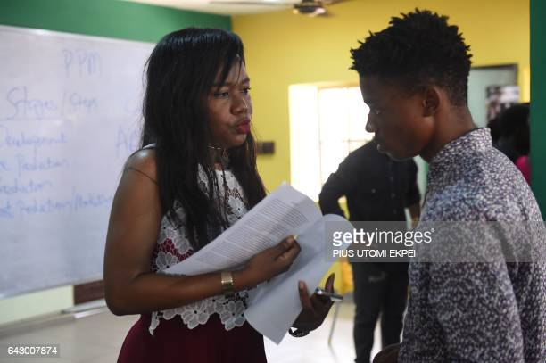 Abiola Adenuga the head of the PEFTI Film Institute speaks to a student at the school in Lagos on February 2 2017 Nollywood film 'The Wedding Party'...