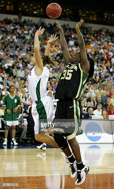 Abiola Wabara of the Baylor Lady Bears knocks the ball away from Kristin Haynie of the Michigan State Spartans in the 2005 Women's NCAA Basketball...