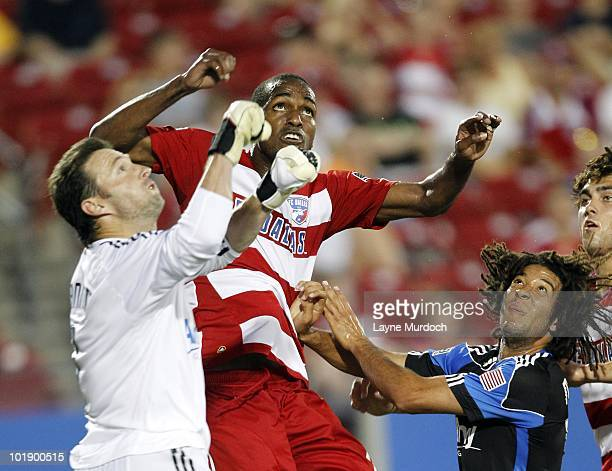 Abita Harris of FC Dallas fights for position against goal keeper Joe Cannon of the San Jose Earthquake at Pizza Hut Park on June 5 2010 in Frisco...