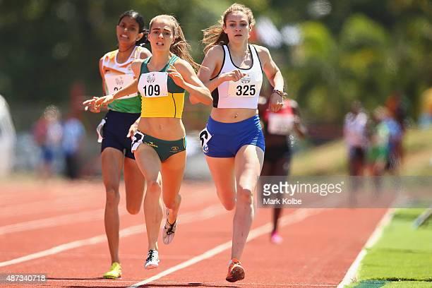 Abitha Mary Manuel of India Amy HardingDelooze of Australia and Carys MCAulay of Scotland race in the girls 800m final during the athletics...
