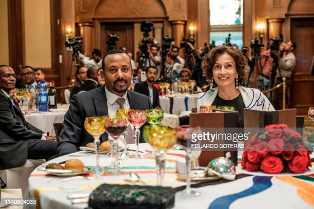 Abiy Ahmed, Prime Minister of Ethiopia and Audrey Azoulay, UNESCO's Director-General, sit at a table during the Guillermo Cano World Press Freedom...