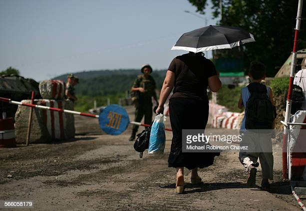 Abkhazian border GEORGIA August 18 2008 A woman walks towards a checkpoint controlled by Russian soldiers at the southern border of the breakaway...