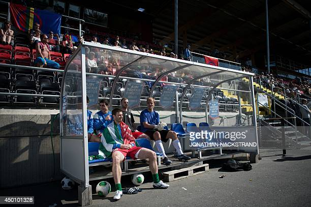 Abkhazian players watch their teammates play during the CONIFA World Football Cup 2014 match Abkhazia vs Sapmi on June 2 2014 in Oestersund Sweden 12...