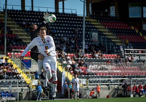 Abkhazia's goalkeeper Aleksei Bondarenko jumps for the ball against Sapmi's Steffen Dreyer during the CONIFA World Football Cup 2014 match between...