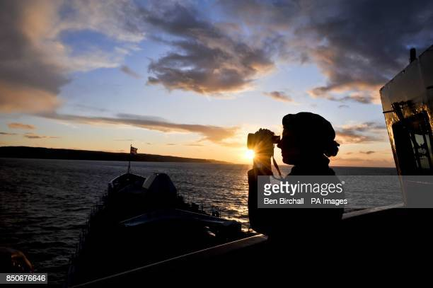 Able Seaman Lisa Aspley from Chesterfield on watch from the Bridge Wing aboard HMS Edinburgh during the ship's farewell tour of the UK heading for...
