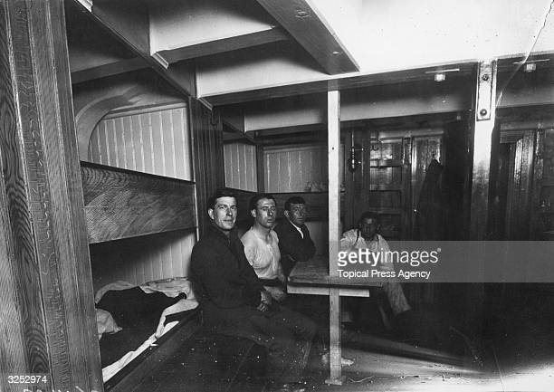 Able Seamen in the forecastle of SS Endurance during preparations for Sir Ernest Shackleton's Antarctic expedition at Millwall Docks in London July...