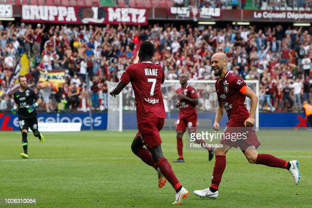 Ablie Jallow of Metz and Ibrahima Niane of Metz celebrates scoring his goal during the French Ligue 2 match between Metz and Lens on September 1 2018...