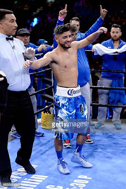 Abner Mares celebrates after defeating Arturo S Reyes during a Premier Boxing Champions bout in the MGM Grand Garden Arena on March 7 2015 in Las...
