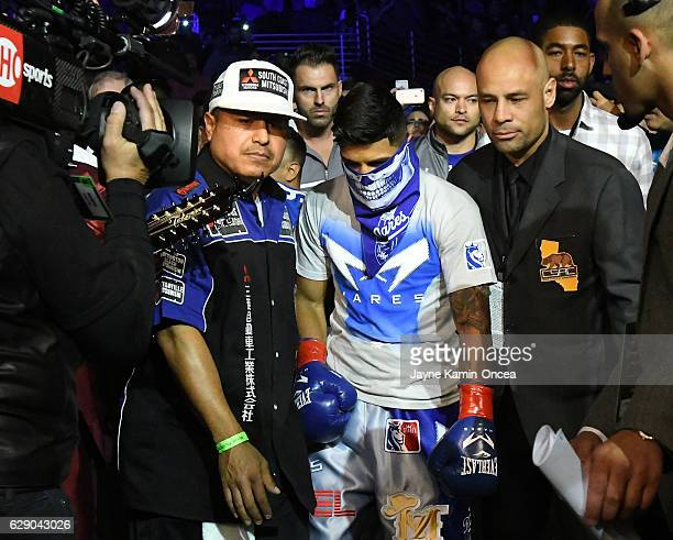 Abner Mares enters the ring with his trainer Robert Garcia for the WBA Featherweight Championship Bout against Jesus Cuellar at the Galen Center at...