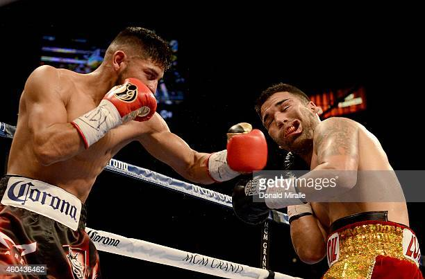 Abner Mares hits Jose Ramirez during their super featherweight fight at the MGM Grand Garden Arena on December 13 2014 in Las Vegas Nevada