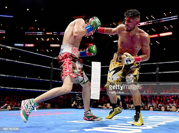Abner Mares of Mexico punches Leo Santa Cruz during the seventh round of the WBC diamond featherweight and WBA featherweight championship bout at...