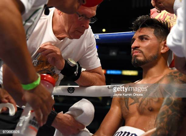 Abner Mares sits in his corner after being defeated by Leo Santa Cruz in their WBA Featherweight Title WBC Diamond Title fight at Staples Center on...