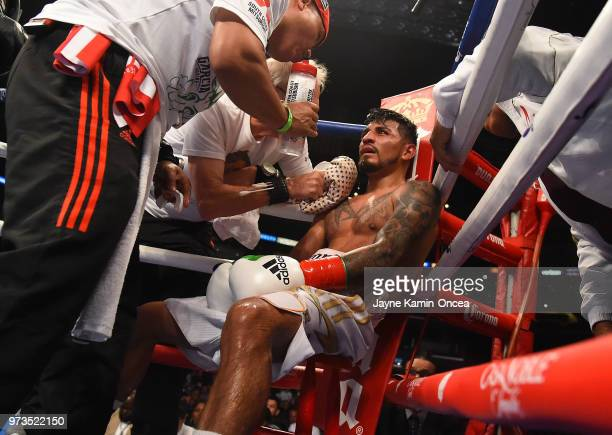 Abner Mares sits in his corner as he was defeated by Leo Santa Cruz in their WBA Featherweight Title WBC Diamond Title fight at Staples Center on...