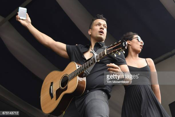 Abner Ramirez and Amanda Sudano of Johnnyswim perform during the 2017 New Orleans Jazz Heritage Festival at Fair Grounds Race Course on April 29 2017...