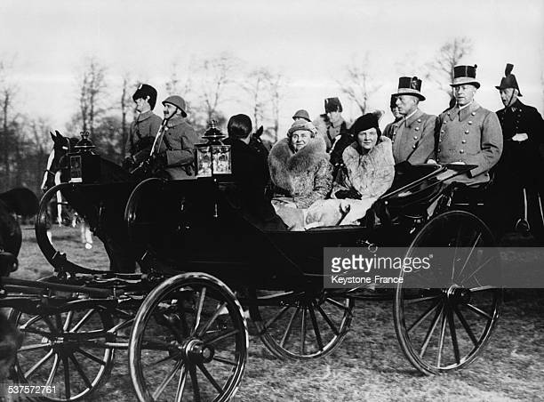 Aboard the carriage in the Malieveld park Queen Wilhelmina is accompanied by Princess Juliana and her fiance Bernhard of Lippe on Decmeber 23 1936 in...