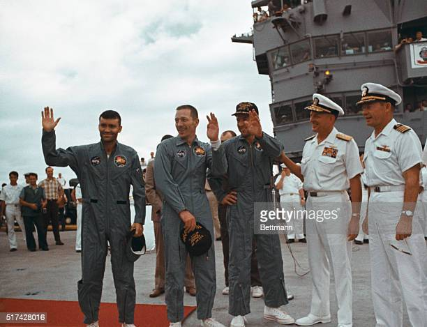 Apollo 13 astronauts wave aboard Iwo Jima aircraft carrier after splashdown in Pacific Left to right Fred W Haise LM Pilot John L Swigert CM Pilot...