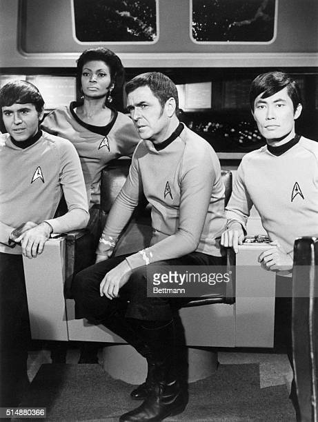 Aboard the main deck of the USS Enterprise are Chekov Uhura Scotty and Sulu