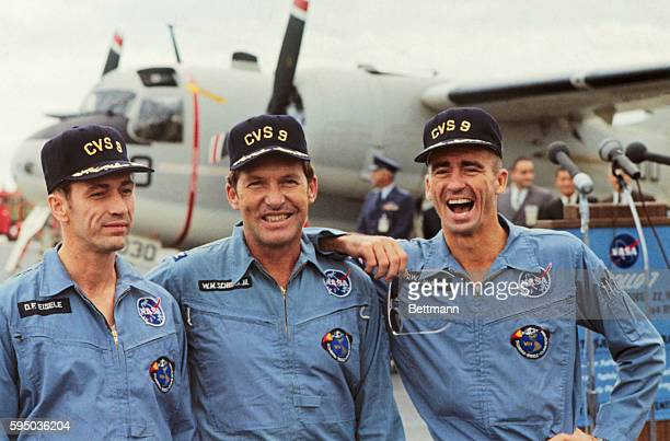 Aboard the USS Essex The three astronauts of the Apollo 7 mission are all smiles following their successful splashdown and recovery October 22 They...