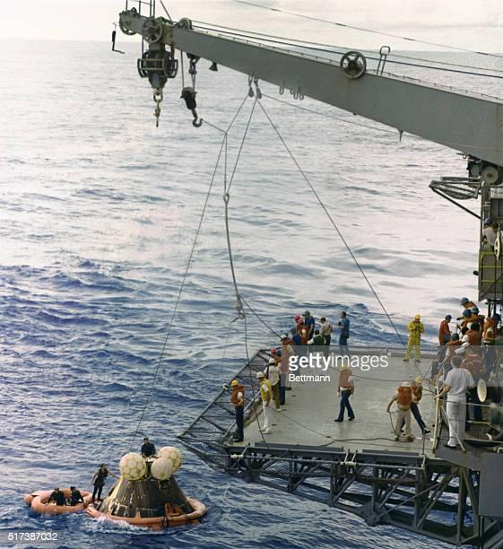 Aboard the USS Iwo Jima The Apollo 13 command module is lifted aboard the recovery carrier Iwo Jima following splashdown here