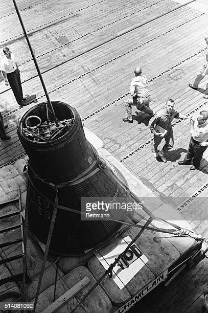 5/5/1961 Aboard the USS Lake Champlain at Sea Astronaut Alan Shepard nation's first maninspace takes a last look at the Mercury spacecraft in which...