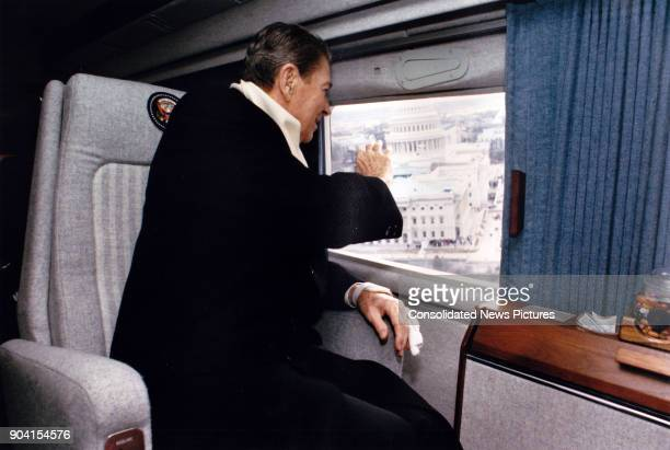 Aboard US Marine helicopter 'Nighthawk 1' former President Ronald Reagan waves out the window as he departs from the US Capitol after President...