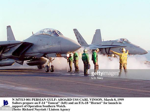 """Aboard USS Carl Vinson In The Persian Gulf -- Sailors Prepare An F-14 """"Tomcat"""" And An F/A-18 """"Hornet"""" For Launch In Support Of Operation Southern..."""