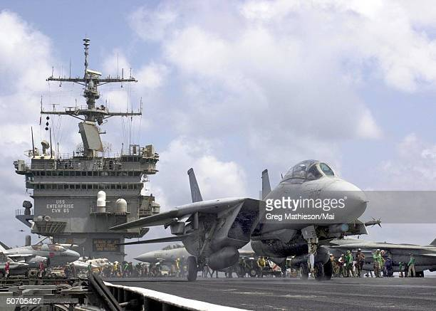 Aboard USS Enterprise an F14A Tomcat taxiing to catapult one for launch from aboard USS Enterprise