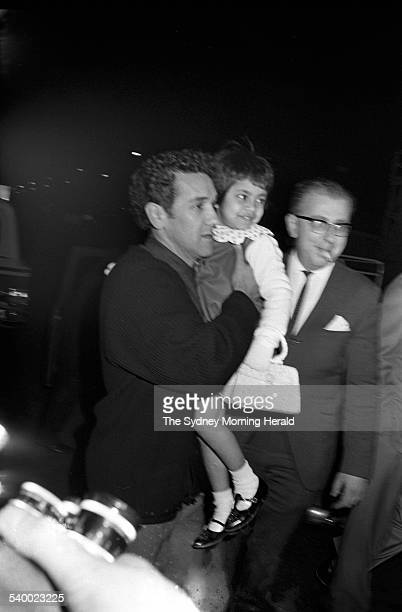 Aboriginal activist Charles Perkins takes Nancy Prasad at Mascot Airport in Sydney 6 August 1965 SMH Picture by TED GOLDING
