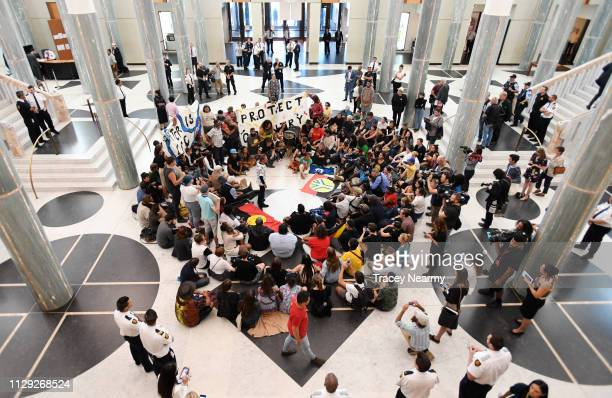Aboriginal and Torres Strait Islander people alongside nonIndigenous allies occupy the foyer and front entry of Parliament House on February 13 2019...